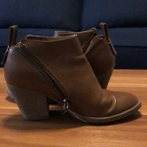 Brown ankle booties with zippers